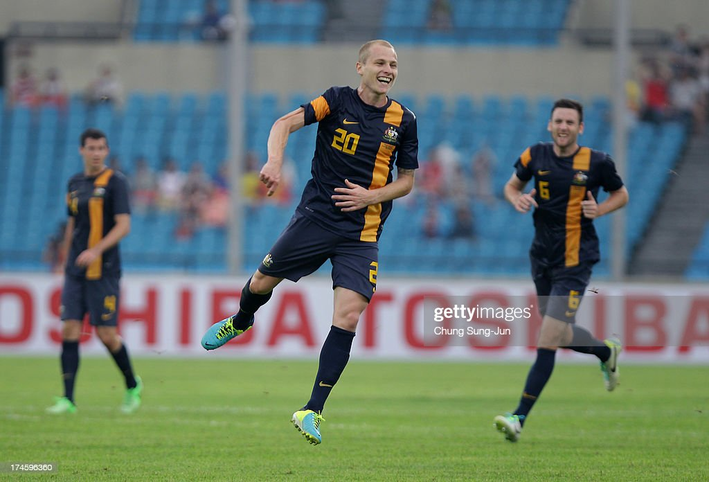 Aaron Mooy (C) of Australia celebrates after scoring a goal during the EAFF East Asian Cup match between Australia and China at Jamsil Stadium on July 28, 2013 in Seoul, South Korea.