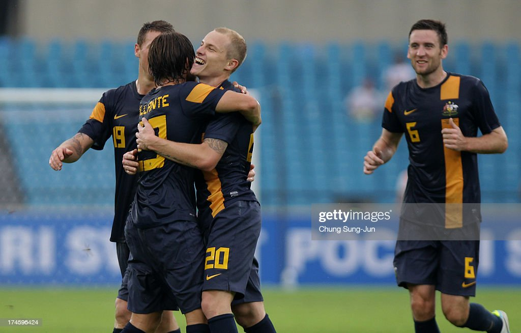 Aaron Mooy #20 of Australia celebrates with team-mates after scoring a goal during the EAFF East Asian Cup match between Australia and China at Jamsil Stadium on July 28, 2013 in Seoul, South Korea.