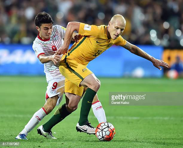 Aaron Mooy of Australia competes for the ball with Alive Jahongir of Tajikistan during the 2018 FIFA World Cup Qualification match between the...