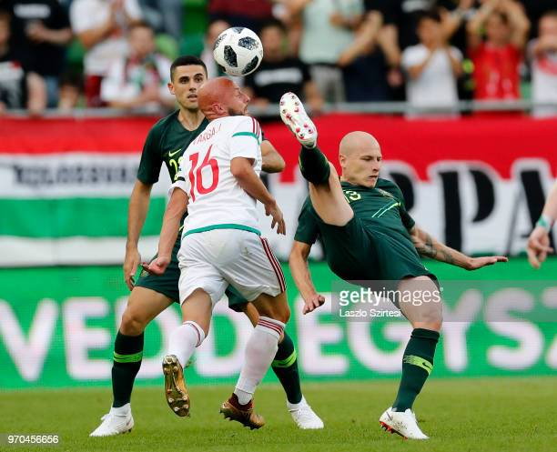 Aaron Mooy of Australia competes for the ball with Jozsef Varga of Hungary before Tom Rogic of Australia during the International Friendly match...