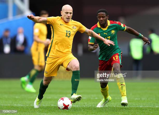 Aaron Mooy of Australia goes past Amaud Djoum of Cameroon during the FIFA Confederations Cup Russia 2017 Group B match between Cameroon and Australia...