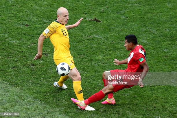 Aaron Mooy of Australia is challenged by Edison Flores of Peru during the 2018 FIFA World Cup Russia group C match between Australia and Peru at...