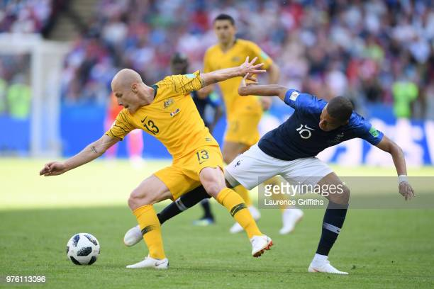 Aaron Mooy of Australia is tackled by Kylian Mbappe of France during the 2018 FIFA World Cup Russia group C match between France and Australia at...