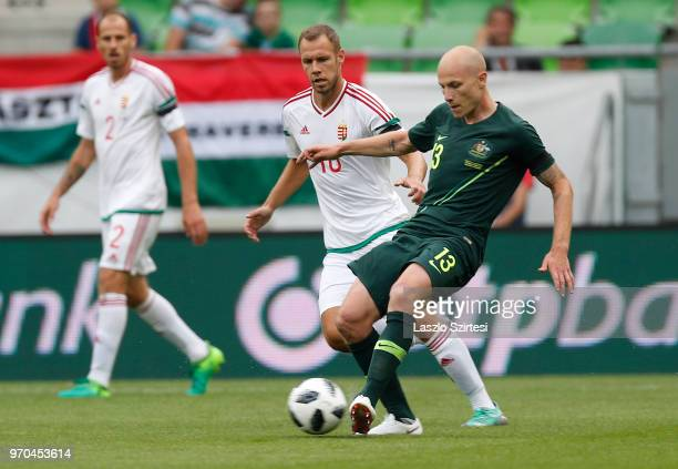 Aaron Mooy of Australia passes the ball next to Krisztian Vadocz of Hungary before Janos Szabo of Hungary during the International Friendly match...