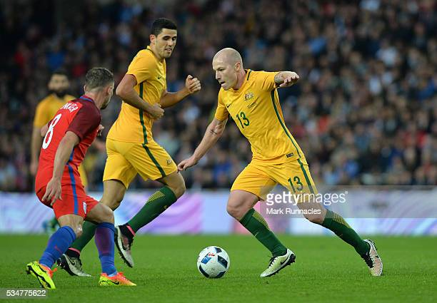 Aaron Mooy of Australia takes on Danny Drinkwater of England during the International Friendly match between England and Australia at Stadium of...
