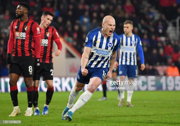 Aaron Mooy of Brighton and Hove Albion celebrates after scoring his team's first goal during the Premier League match between AFC Bournemouth and...
