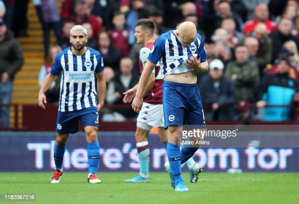 Aaron Mooy of Brighton and Hove Albion reacts after being sent off during the Premier League match between Aston Villa and Brighton Hove Albion at...