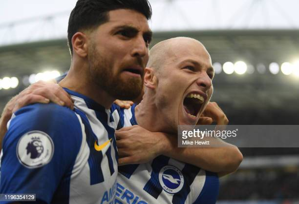 Aaron Mooy of Brighton Hove Albion celebrates with Alireza Jahanbakhsh after scoring his teams second goal during the Premier League match between...