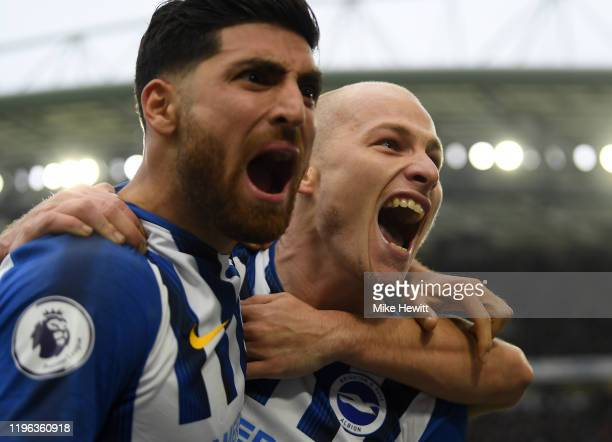 Aaron Mooy of Brighton Hove Albion celebrates with fellow goalscorer Alireza Jahanbakhsh after putting his side two up during the Premier League...
