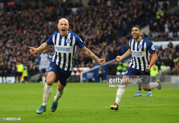 Aaron Mooy of Brighton & Hove Albion celebrates with Neal Maupay after scoring his teams second goal during the Premier League match between Brighton...