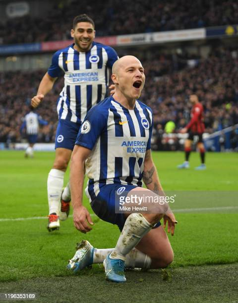 Aaron Mooy of Brighton Hove Albion celebrates with Neal Maupay after scoring his teams second goal during the Premier League match between Brighton...