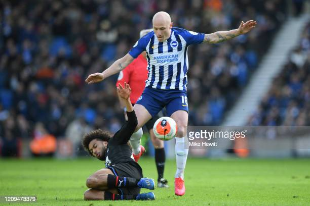 Aaron Mooy of Brighton Hove Albion is tackled by Jairo Riedewald of Crystal Palace during the Premier League match between Brighton Hove Albion and...