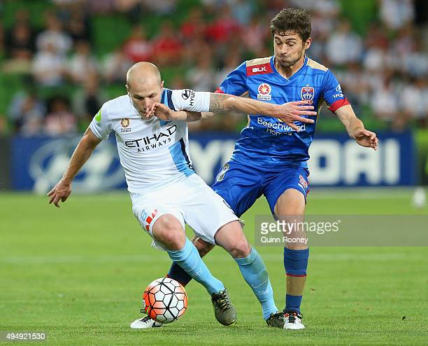 Aaron Mooy of City and Mateo Poljak of the Jets compete for the ball during the round four ALeague match between Melbourne City FC and Newcastle Jets...