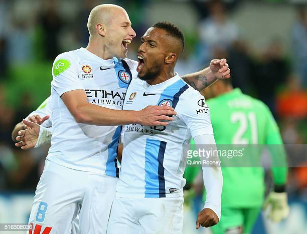 Aaron Mooy of City celebrates with team mates after scoring a goal during the round 24 ALeague match between Melbourne City and Brisbane Roar at AAMI...