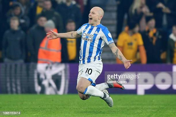 Aaron Mooy of Huddersfield celebrates after scoring his team's first goal during the Premier League match between Wolverhampton Wanderers and...