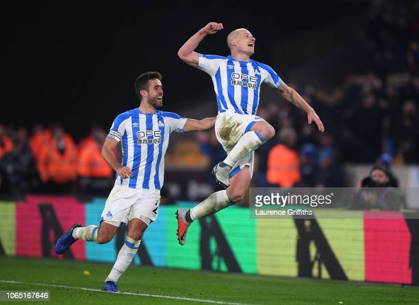 Aaron Mooy of Huddersfield celebrates after scoring his team's second goal during the Premier League match between Wolverhampton Wanderers and...