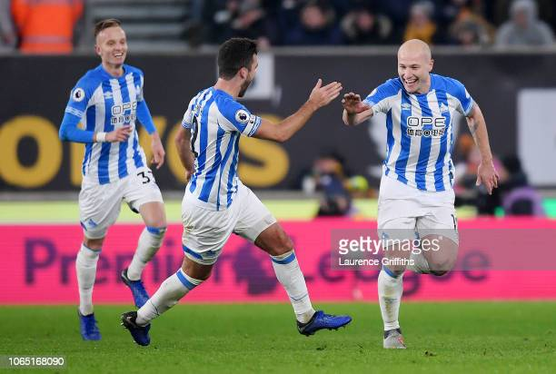 Aaron Mooy of Huddersfield celebrates after scoring his team's second goal with Tommy Smith Huddersfield during the Premier League match between...