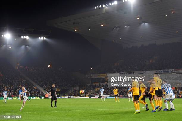 Aaron Mooy of Huddersfield scores his team's second goal during the Premier League match between Wolverhampton Wanderers and Huddersfield Town at...