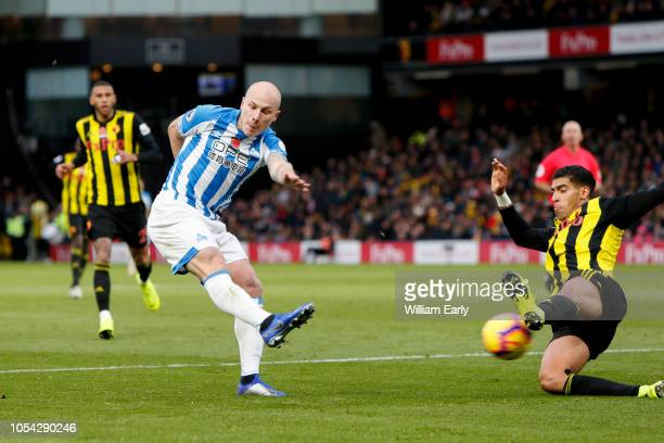 Aaron Mooy of Huddersfield Town and Adam Masina of Watford FC during the Premier League match between Watford FC and Huddersfield Town at Vicarage...