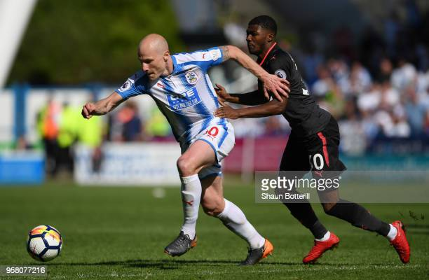 Aaron Mooy of Huddersfield Town and Ainsley MaitlandNiles of Arsenal battle for possession during the Premier League match between Huddersfield Town...