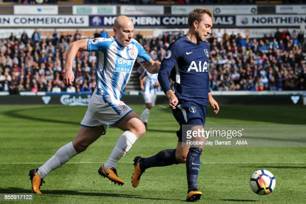 Aaron Mooy of Huddersfield Town and Christian Eriksen of Tottenham Hotspur during the Premier League match between Huddersfield Town and Tottenham...