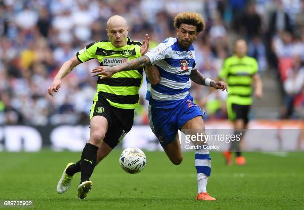 Aaron Mooy of Huddersfield Town and Daniel Williams of Reading battle for possession during the Sky Bet Championship play off final between...