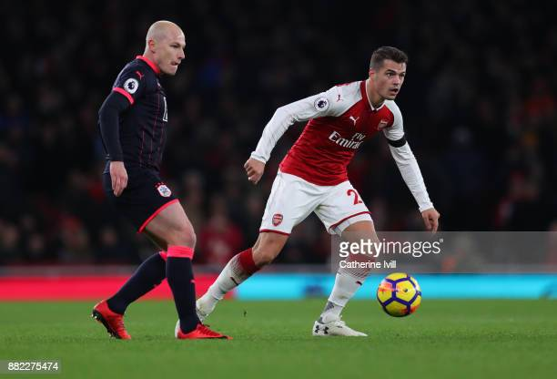 Aaron Mooy of Huddersfield Town and Granit Xhaka of Arsenal during the Premier League match between Arsenal and Huddersfield Town at Emirates Stadium...
