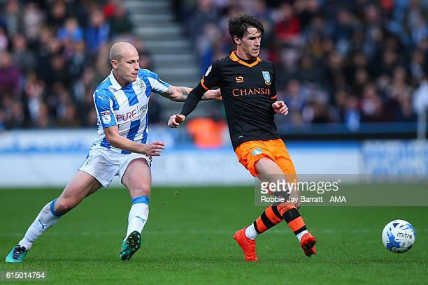 Aaron Mooy of Huddersfield Town and Kieran Lee of Sheffield Wednesday during the Sky Bet Championship match between Huddersfield Town and Sheffield...