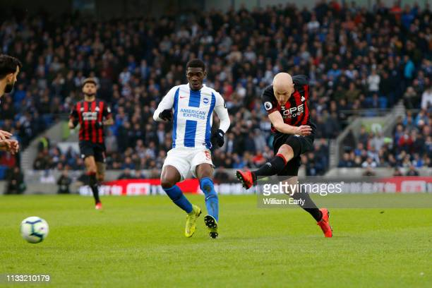 Aaron Mooy of Huddersfield Town and Yves Bissouma of Brighton Hove Albion during the Premier League match between Brighton Hove Albion and...