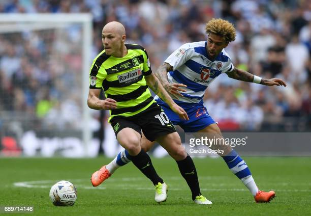 Aaron Mooy of Huddersfield Town attempts to get away from Daniel Williams of Reading during the Sky Bet Championship play off final between...