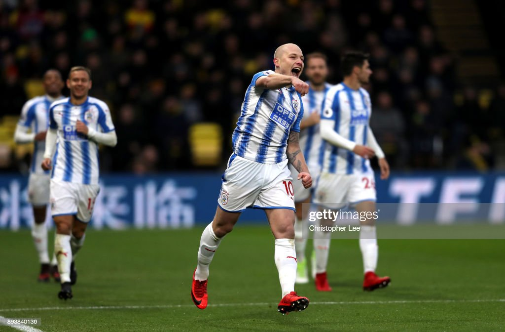 Aaron Mooy of Huddersfield Town celebrates after scores his sides second goal during the Premier League match between Watford and Huddersfield Town at Vicarage Road on December 16, 2017 in Watford, England.