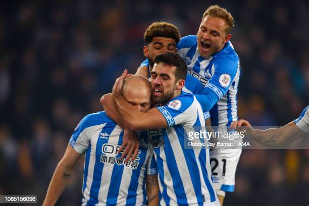 Aaron Mooy of Huddersfield Town celebrates after scoring a goal to make it 0-1 during the Premier League match between Wolverhampton Wanderers and...