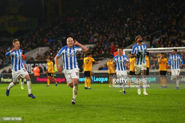 Aaron Mooy of Huddersfield Town celebrates after scoring a goal to make it 0-2 during the Premier League match between Wolverhampton Wanderers and...