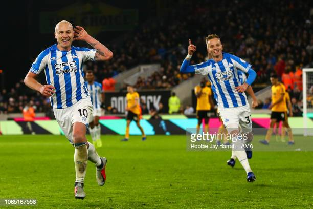 Aaron Mooy of Huddersfield Town celebrates after scoring a goal to make it 02 during the Premier League match between Wolverhampton Wanderers and...