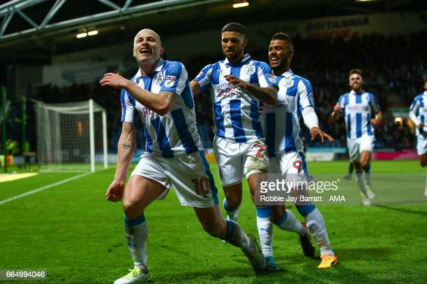 Aaron Mooy of Huddersfield Town celebrates after scoring a goal to make it 20 during the Sky Bet Championship match between Huddersfield Town and...