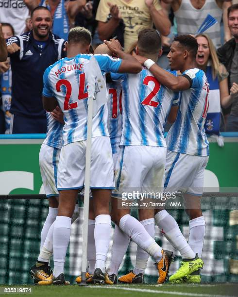 Aaron Mooy of Huddersfield Town celebrates after scoring a goal to make it 10 during the Premier League match between Huddersfield Town and Newcastle...
