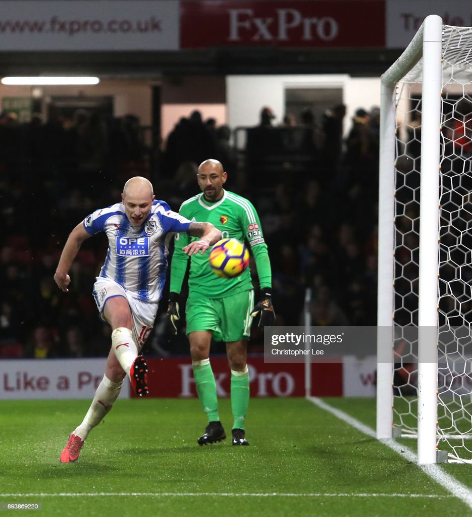 Aaron Mooy of Huddersfield Town celebrates after scoring his sides fourth goal during the Premier League match between Watford and Huddersfield Town at Vicarage Road on December 16, 2017 in Watford, England.