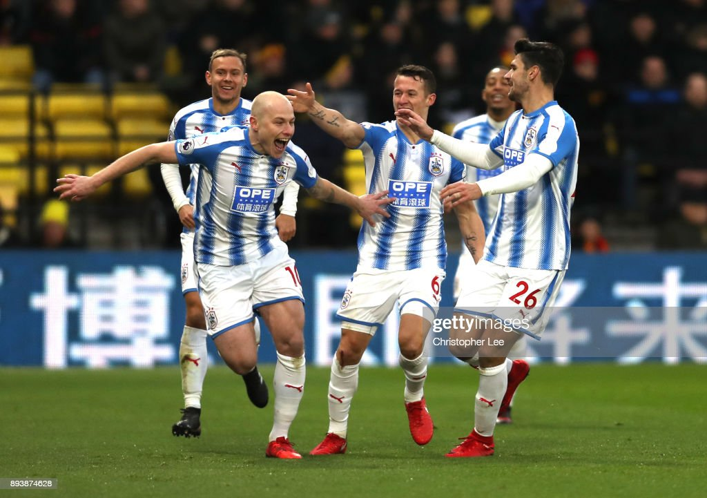 Aaron Mooy of Huddersfield Town celebrates after scoring his sides second goal with his team mates during the Premier League match between Watford and Huddersfield Town at Vicarage Road on December 16, 2017 in Watford, England.