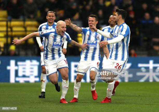 Aaron Mooy of Huddersfield Town celebrates after scoring his sides second goal with his team mates during the Premier League match between Watford...