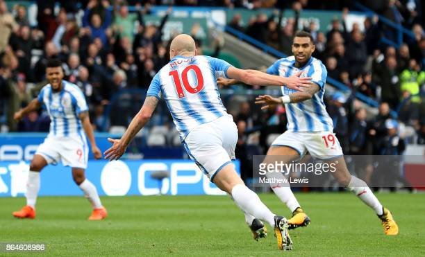 Aaron Mooy of Huddersfield Town celebrates as he scores their first goal during the Premier League match between Huddersfield Town and Manchester...