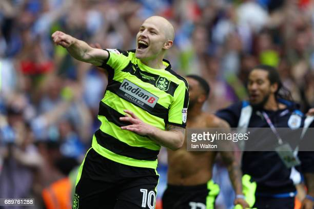 Aaron Mooy of Huddersfield Town celebrates as his side win the penalty shoot out and promotion to the Premier League during the Sky Bet Championship...