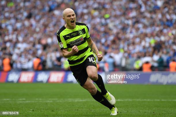 Aaron Mooy of Huddersfield Town celebrates scoring his sides fourth penalty in the penalty shoot out during the Sky Bet Championship play off final...