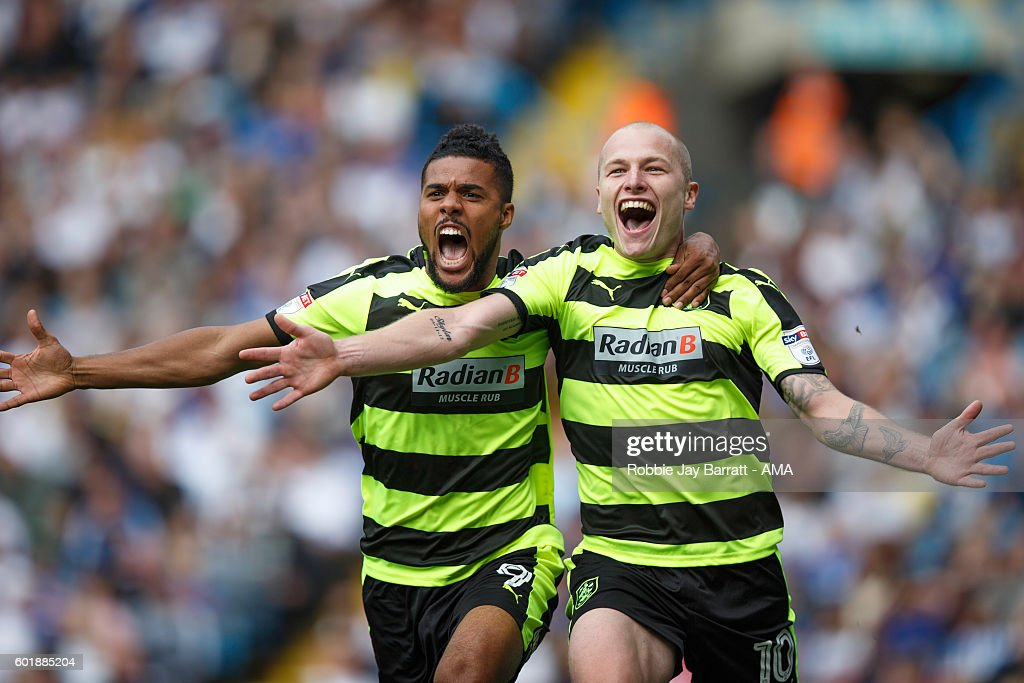 Aaron Mooy of Huddersfield Town celebrates with Elias Kachunga of Huddersfield Town after scoring to make it 0-1 during the Sky Bet Championship match between Leeds United and Huddersfield Town at Elland Road on September 10, 2016 in Leeds, England.