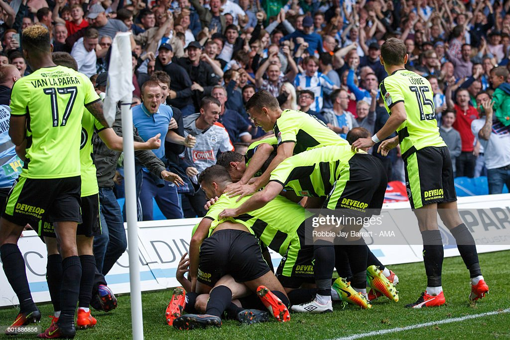 Aaron Mooy of Huddersfield Town gets mobbed by his team mates after he scores a goal to make it 0-1 during the Sky Bet Championship match between Leeds United and Huddersfield Town at Elland Road on September 10, 2016 in Leeds, England.