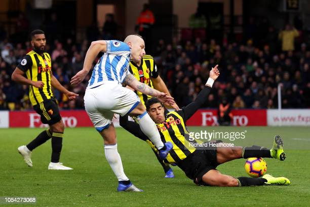Aaron Mooy of Huddersfield Town has his shot blocked by Adam Masina of Watford during the Premier League match between Watford FC and Huddersfield...