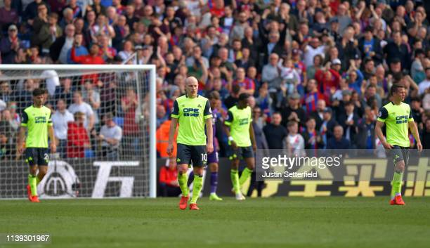 Aaron Mooy of Huddersfield Town looks dejected after Crystal Palace's first goal during the Premier League match between Crystal Palace and...