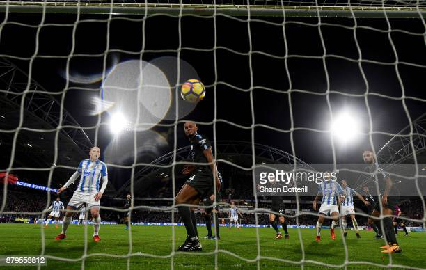 Aaron Mooy of Huddersfield Town looks on after Nicolas Otamendi of Manchester City scored the first own goal as Vincent Kompany of Manchester City...