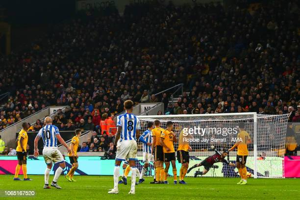 Aaron Mooy of Huddersfield Town scores a goal to make it 02 during the Premier League match between Wolverhampton Wanderers and Huddersfield Town at...