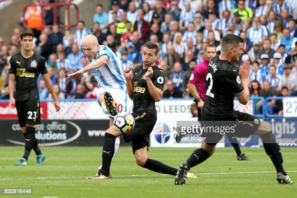 Aaron Mooy of Huddersfield Town scores his sides first goal during the Premier League match between Huddersfield Town and Newcastle United at John...