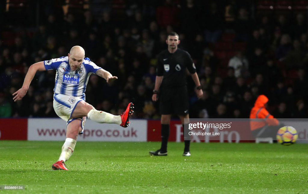 Aaron Mooy of Huddersfield Town scores his sides fourth goal during the Premier League match between Watford and Huddersfield Town at Vicarage Road on December 16, 2017 in Watford, England.